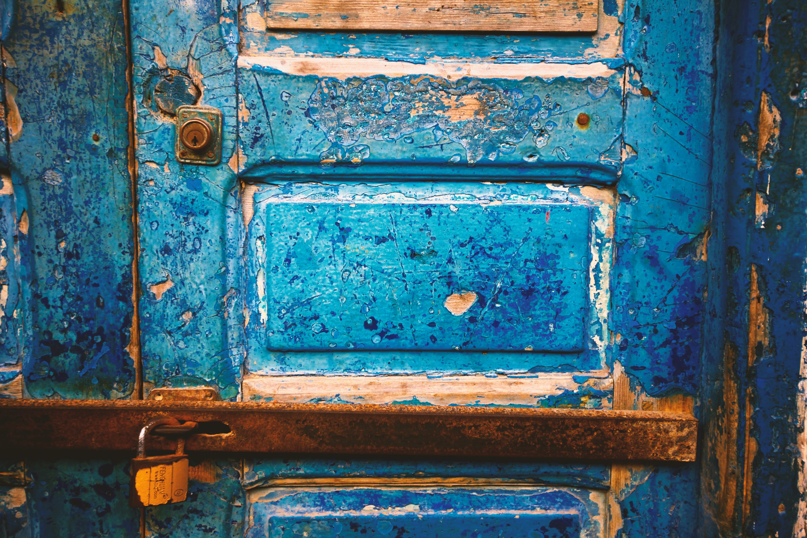 focus photography of blue wooden closed door