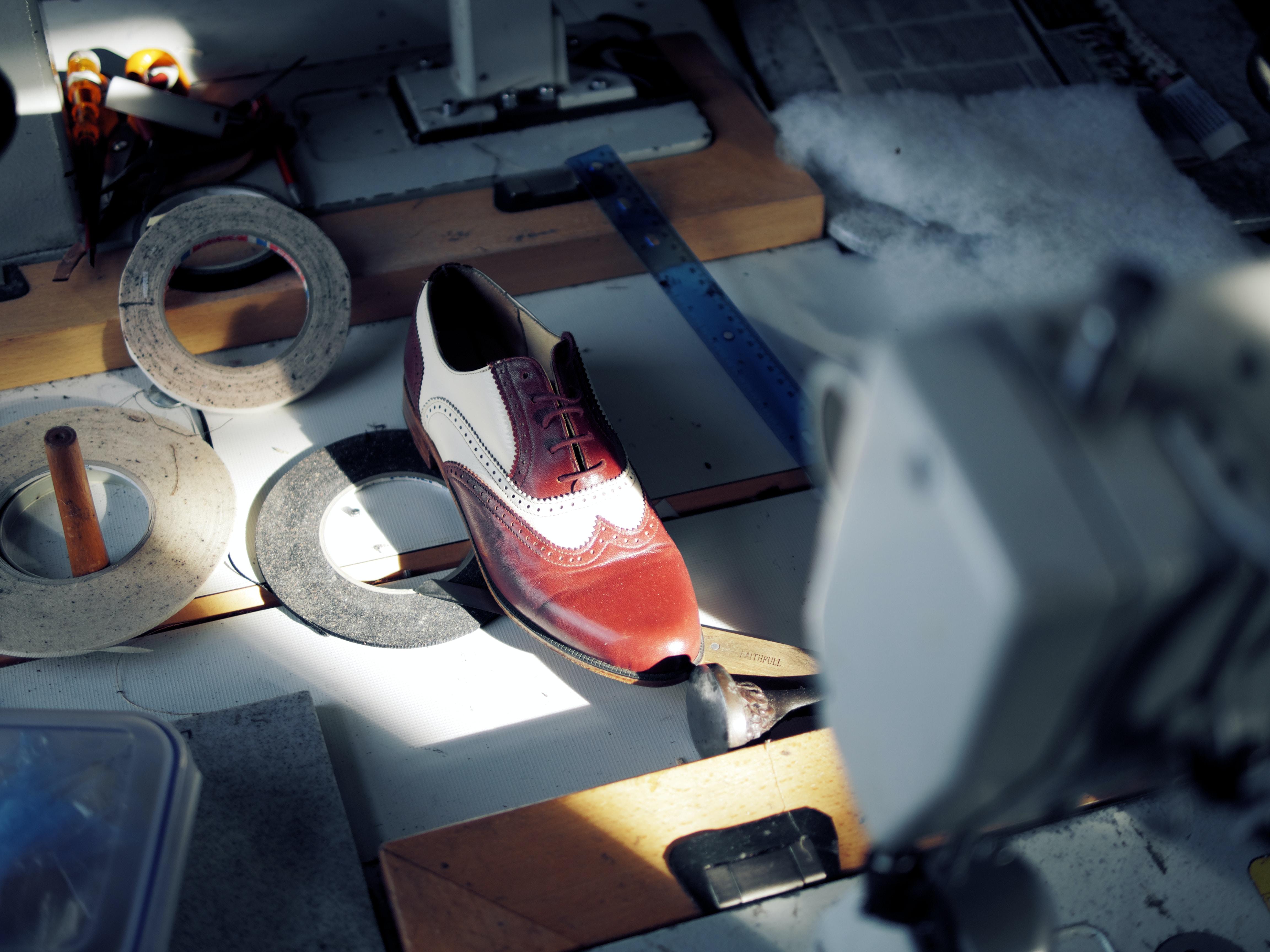 unpaired brown dress shoe