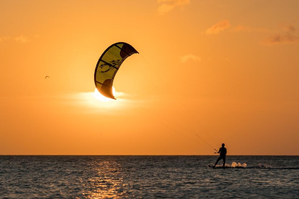 man surfing during sunset