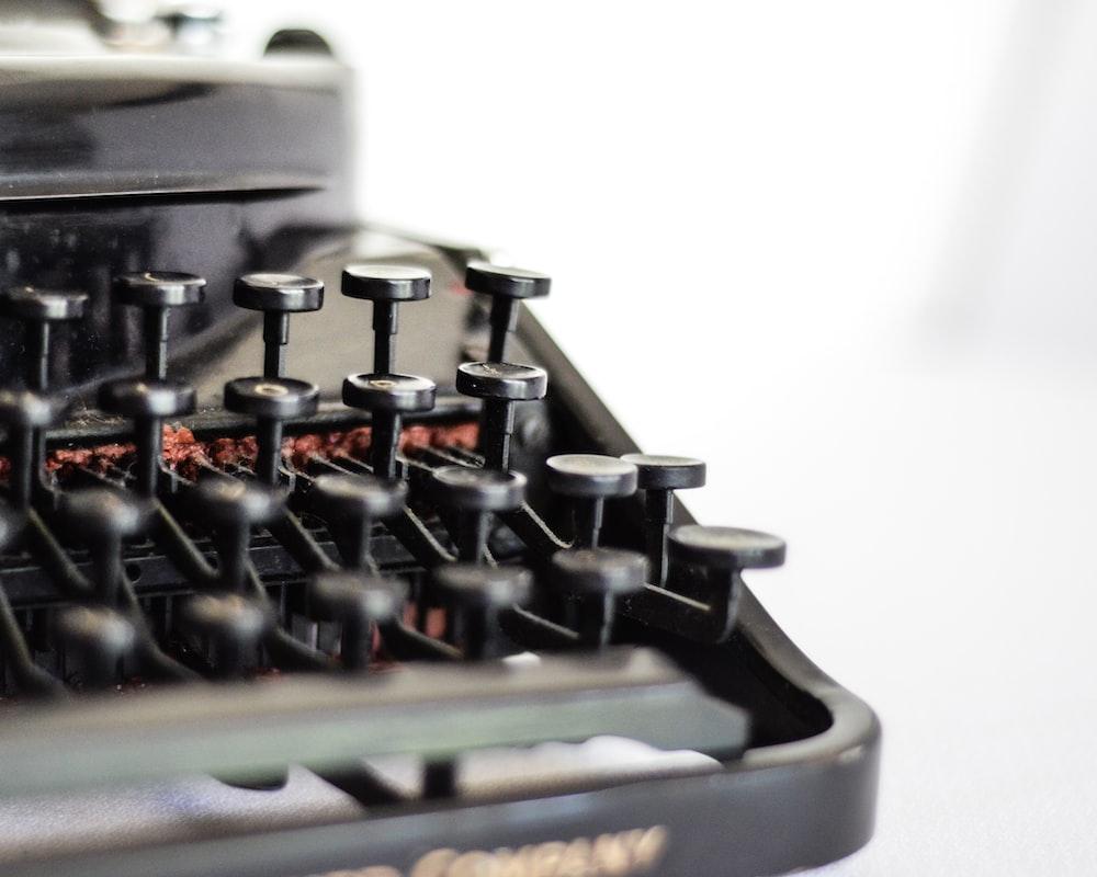 selective focus photography of typewriter keys