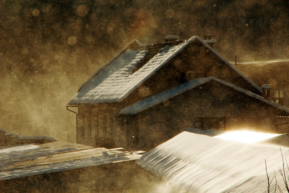 snow-coated brown house painting