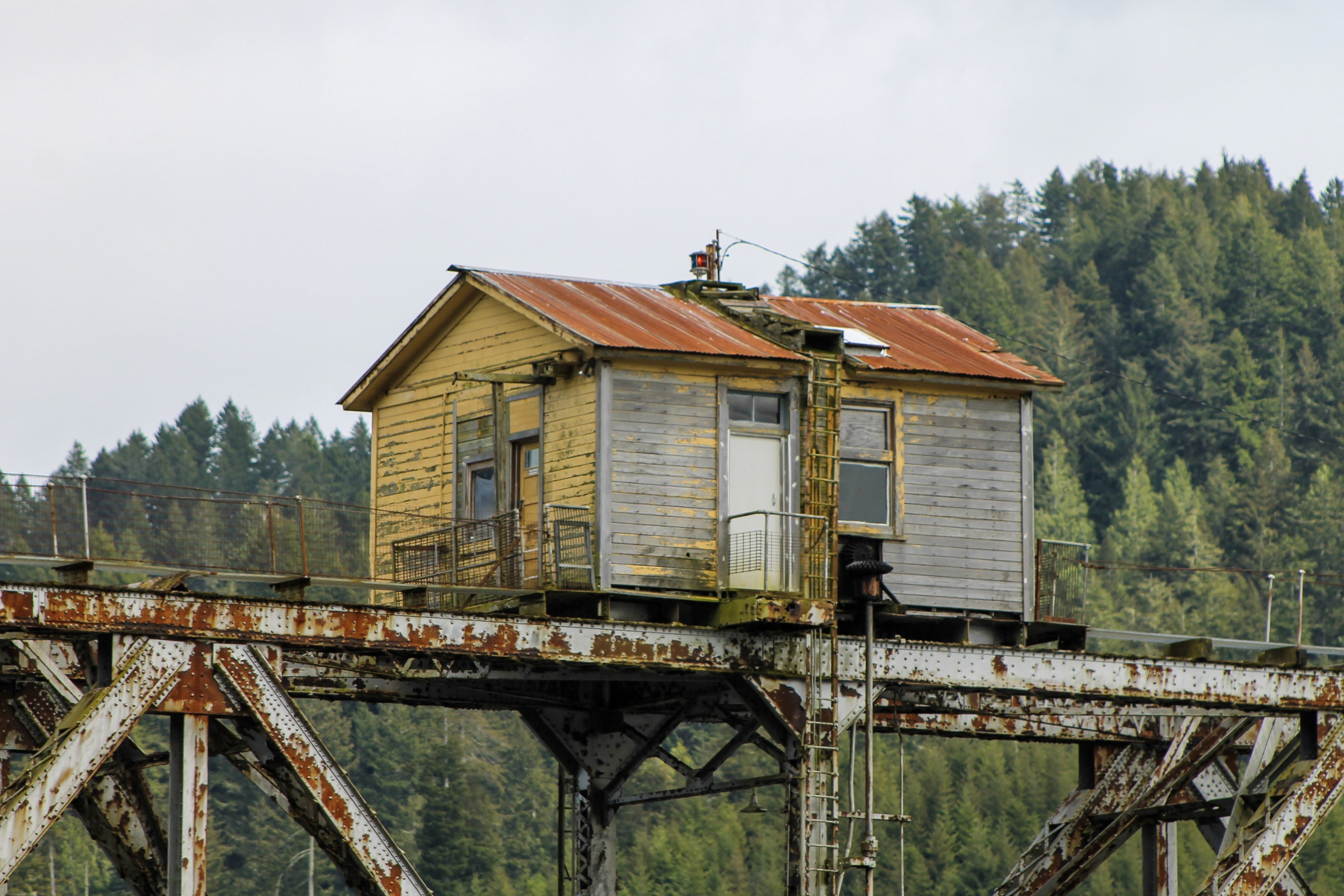 yellow and brown wooden house on rusted steel beams