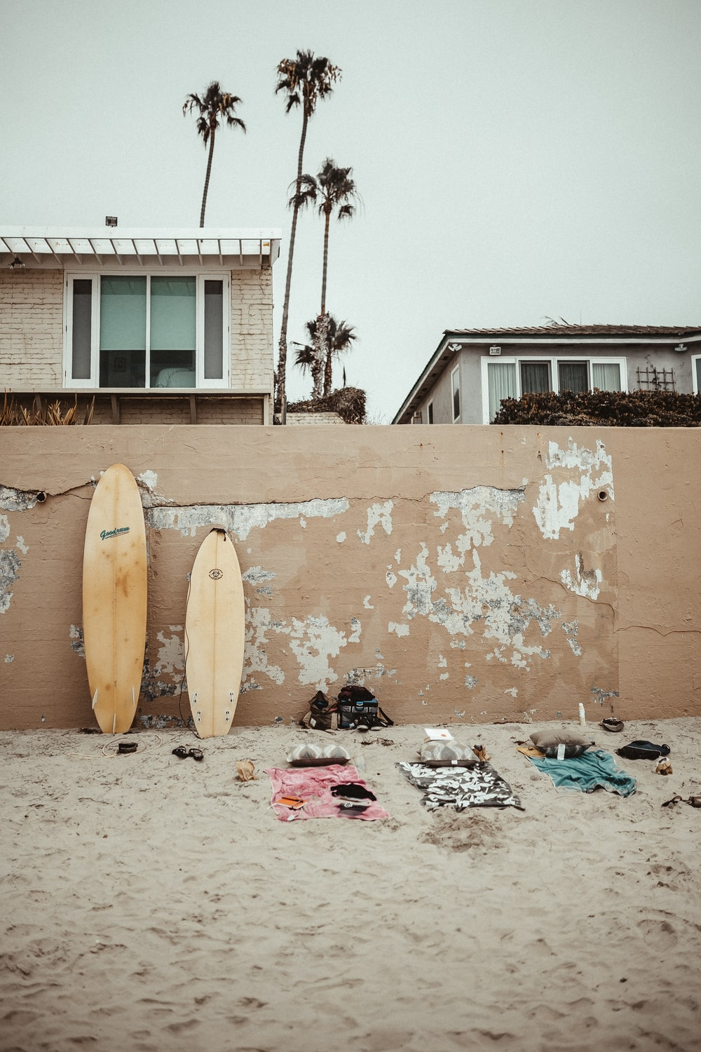 beige surfboards on the wall beside the beach
