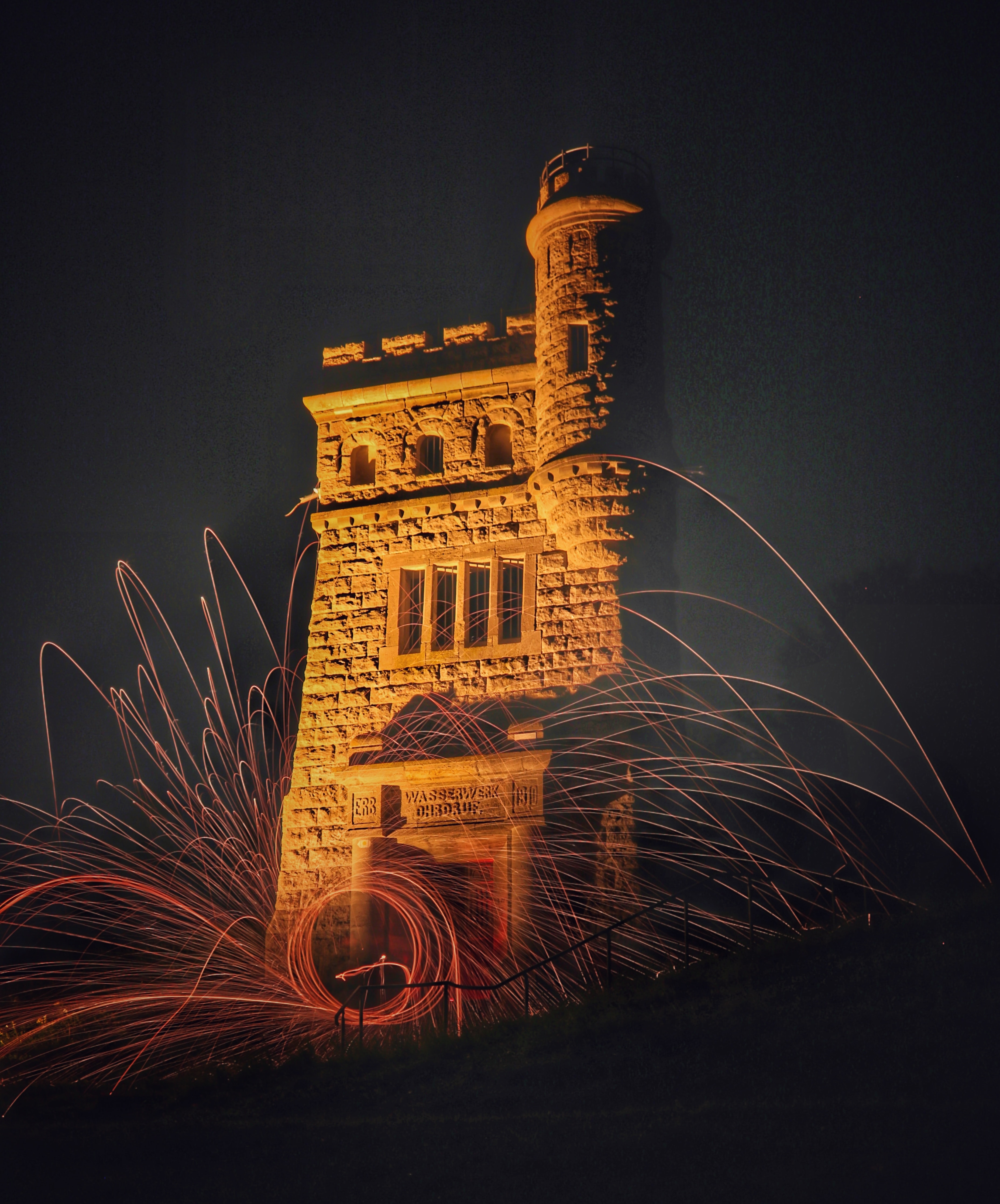 time lapse photography of steel wool beside concrete building