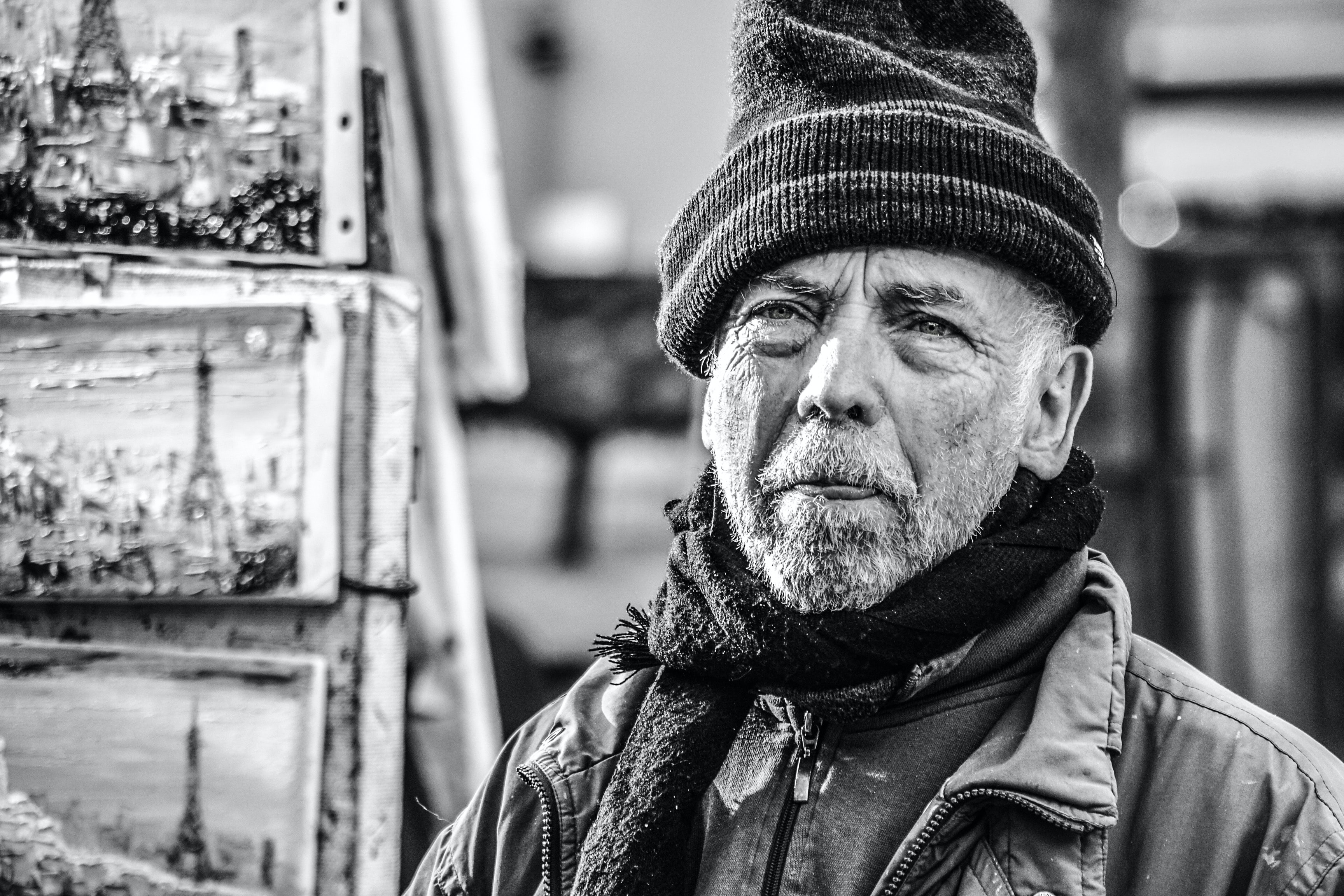 grayscale photography of man with beanie cap and scarf