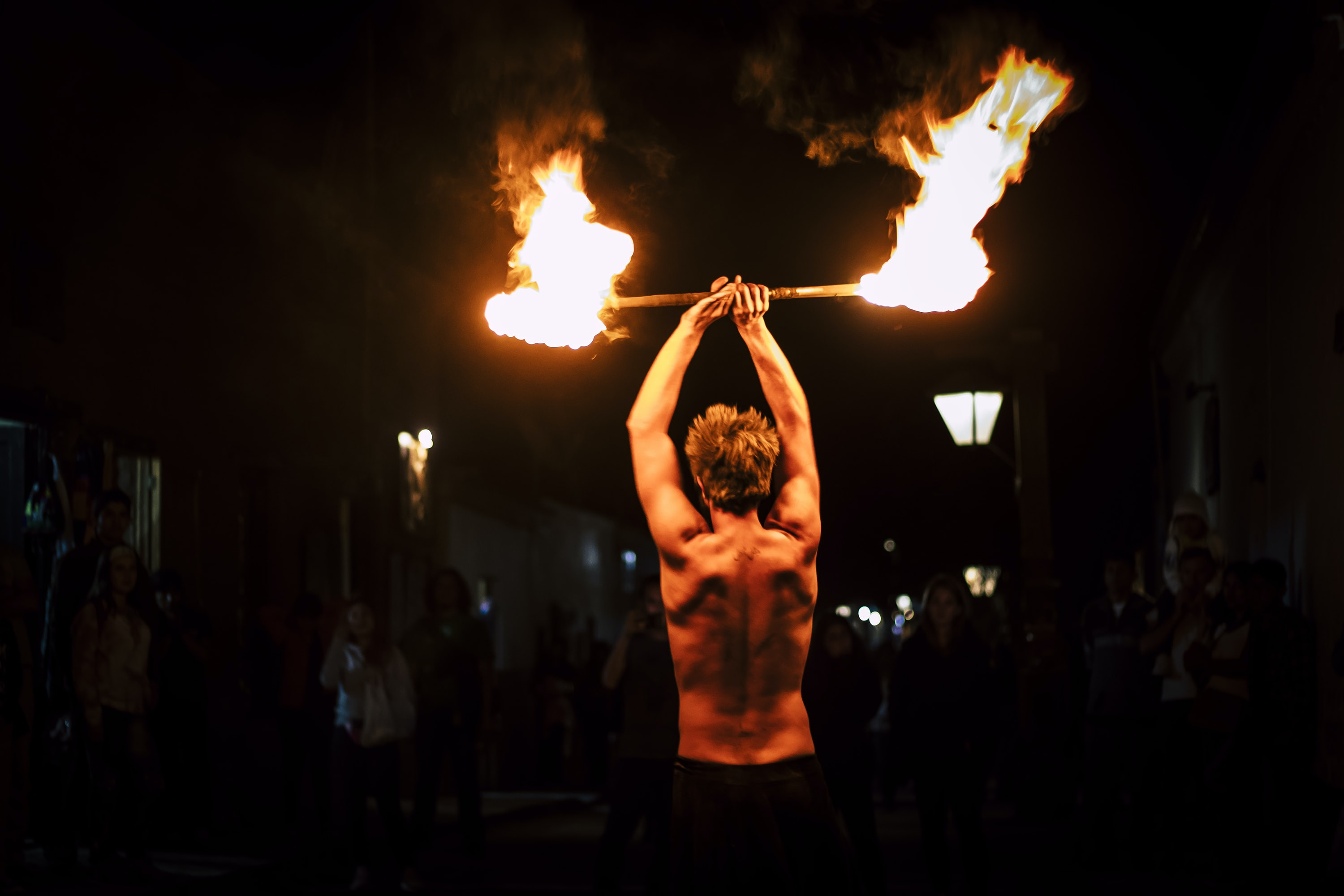 man demonstrating fire dance