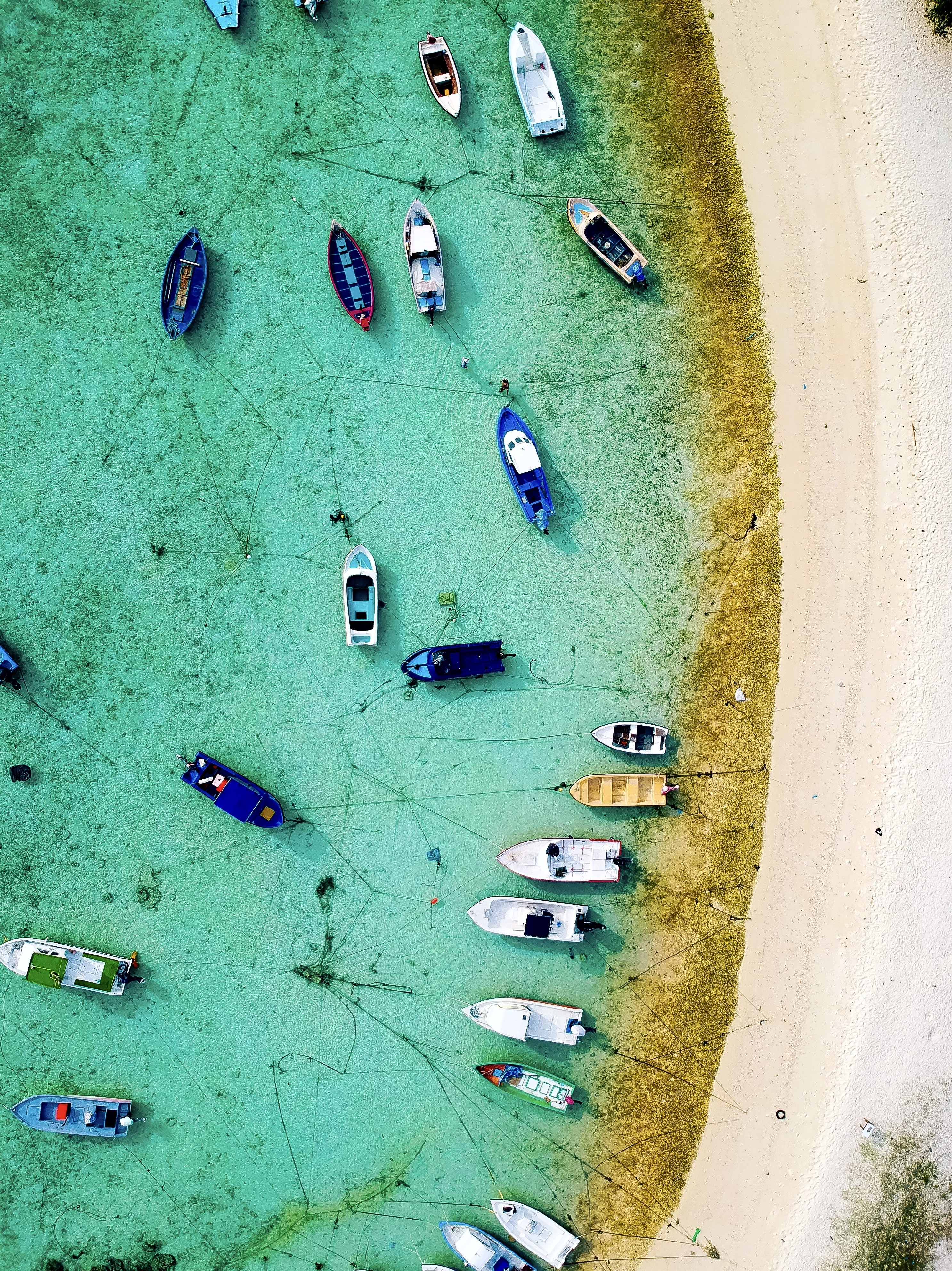 aerial view of boat on body of water during daytime