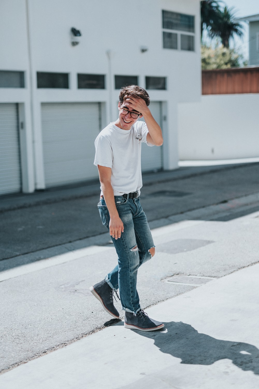 man standing on concrete pavement