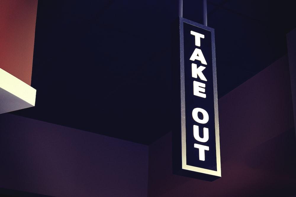 closeup photo of takeout signage