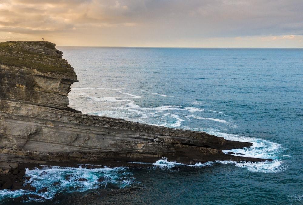 rock monolith beside seashore