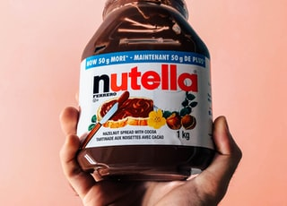 person holding Nutella jar