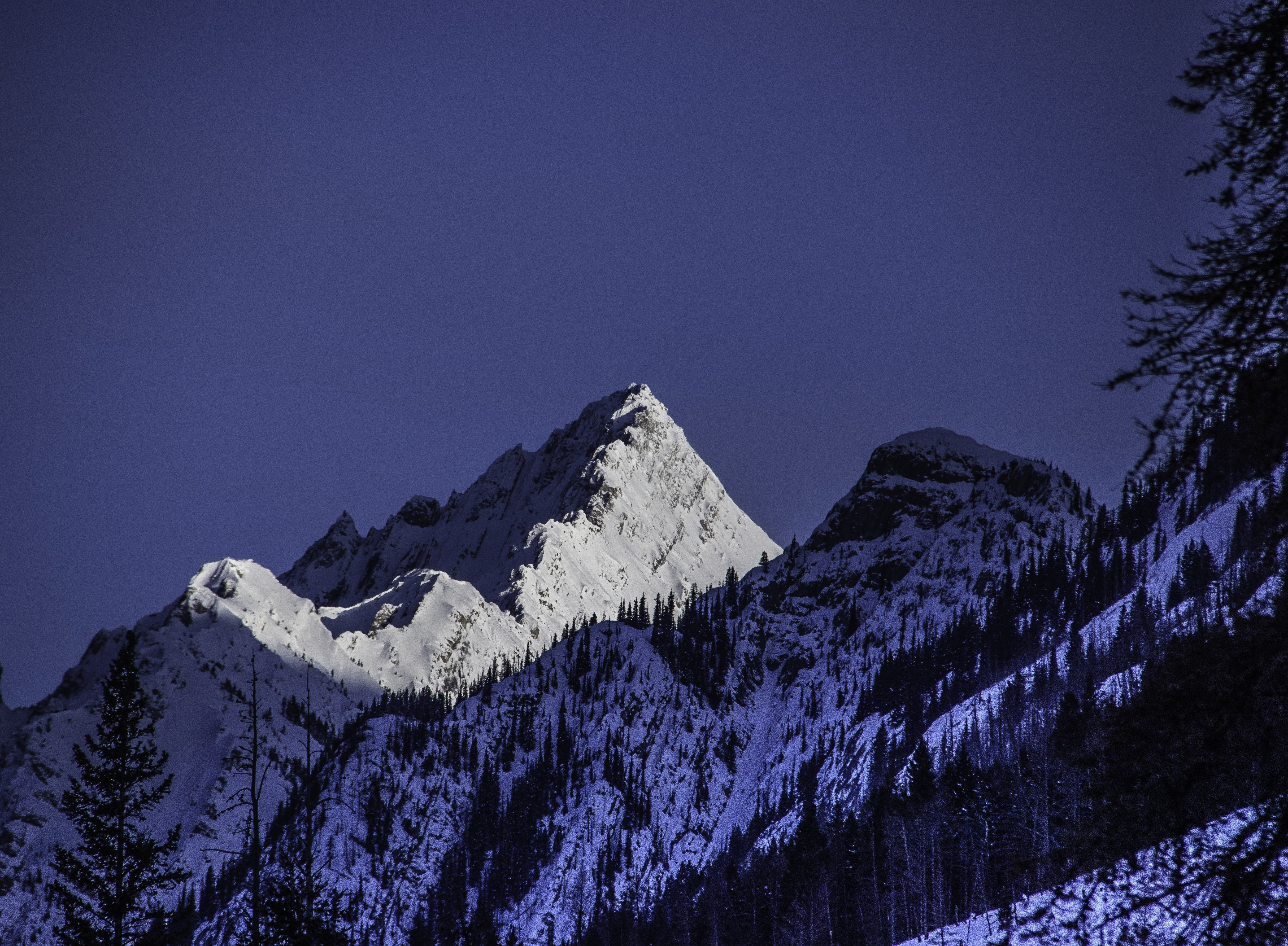 low-angle photography of white mountain