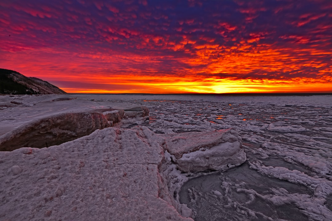 The red sky making the ice glow red as it sets