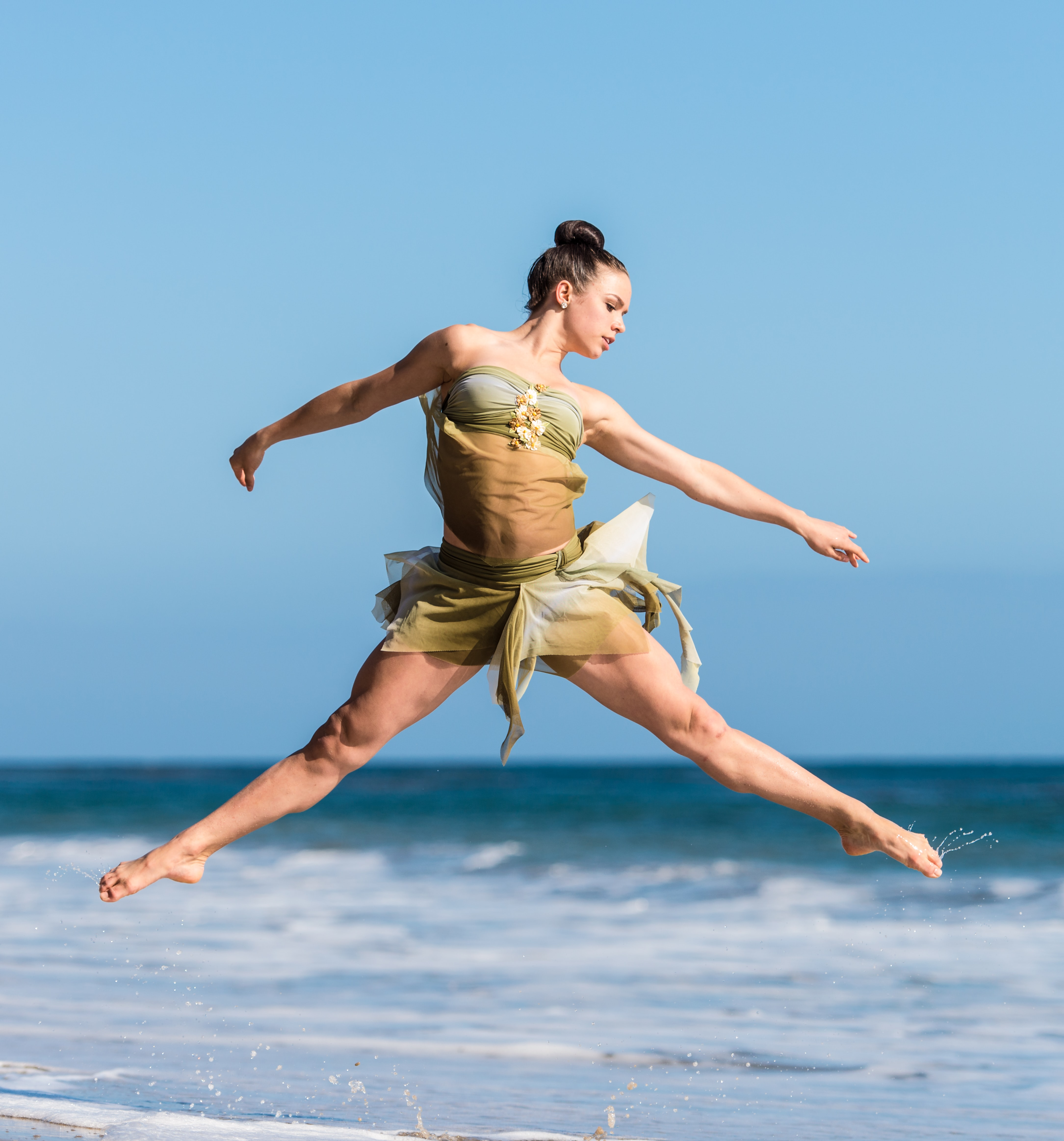 woman dancing beside body of water during daytime