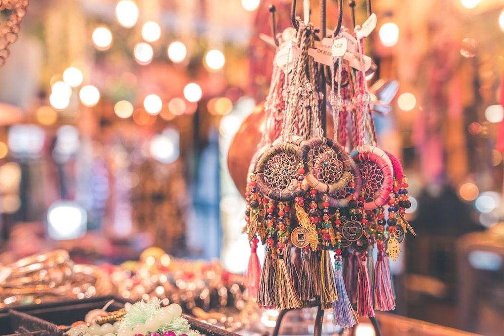 assorted-color dreamcatcher necklaces
