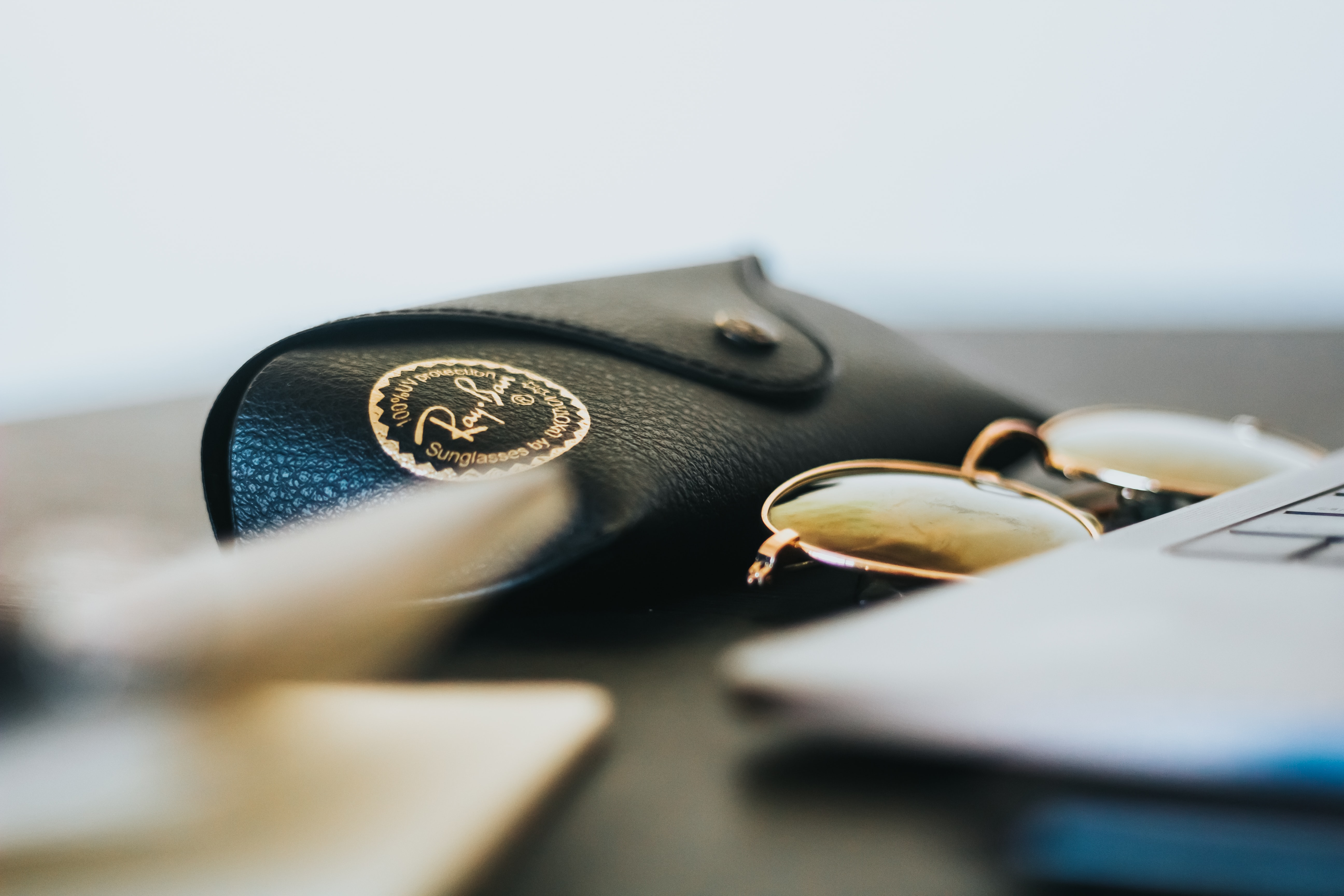 black Ray-Ban sunglasses with leather case