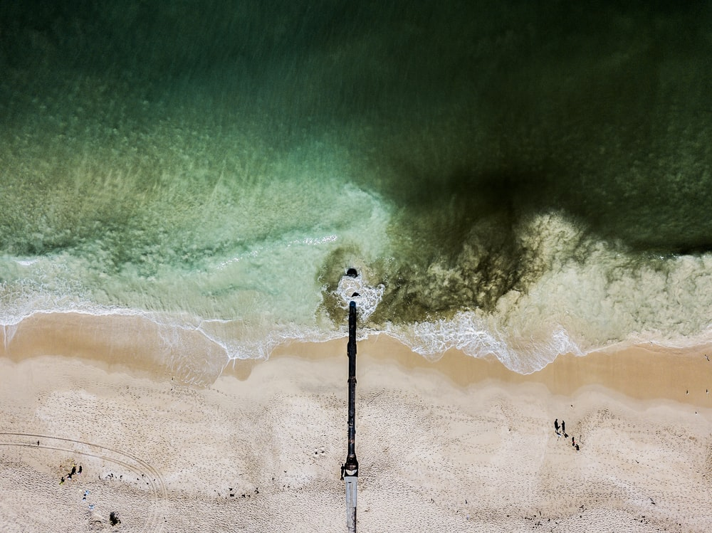 aerial view photography of beach dock near body of water