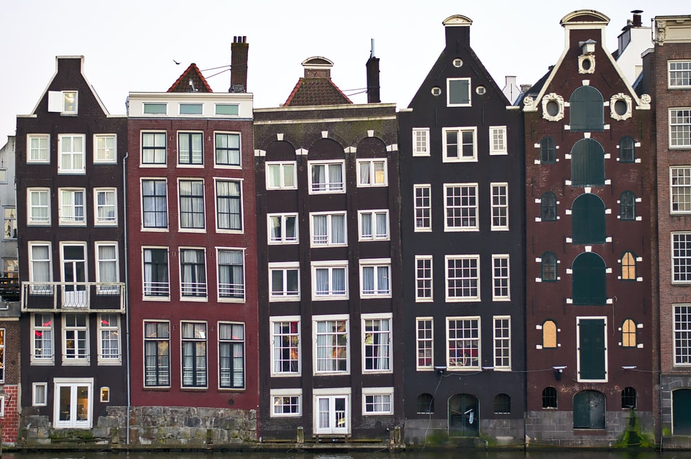 assorted-color houses under white sky