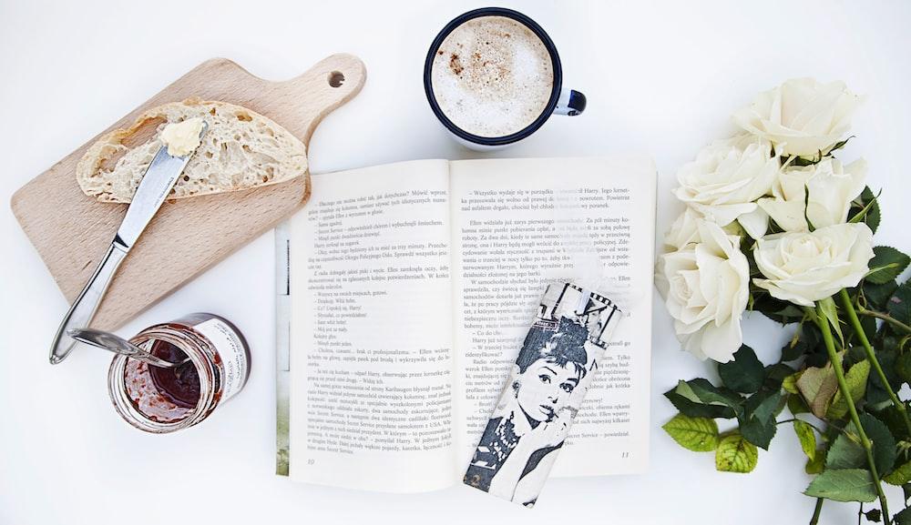 white roses near book