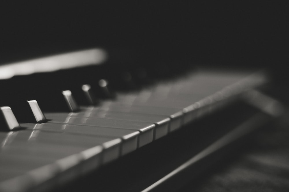 grayscale photography of piano keys