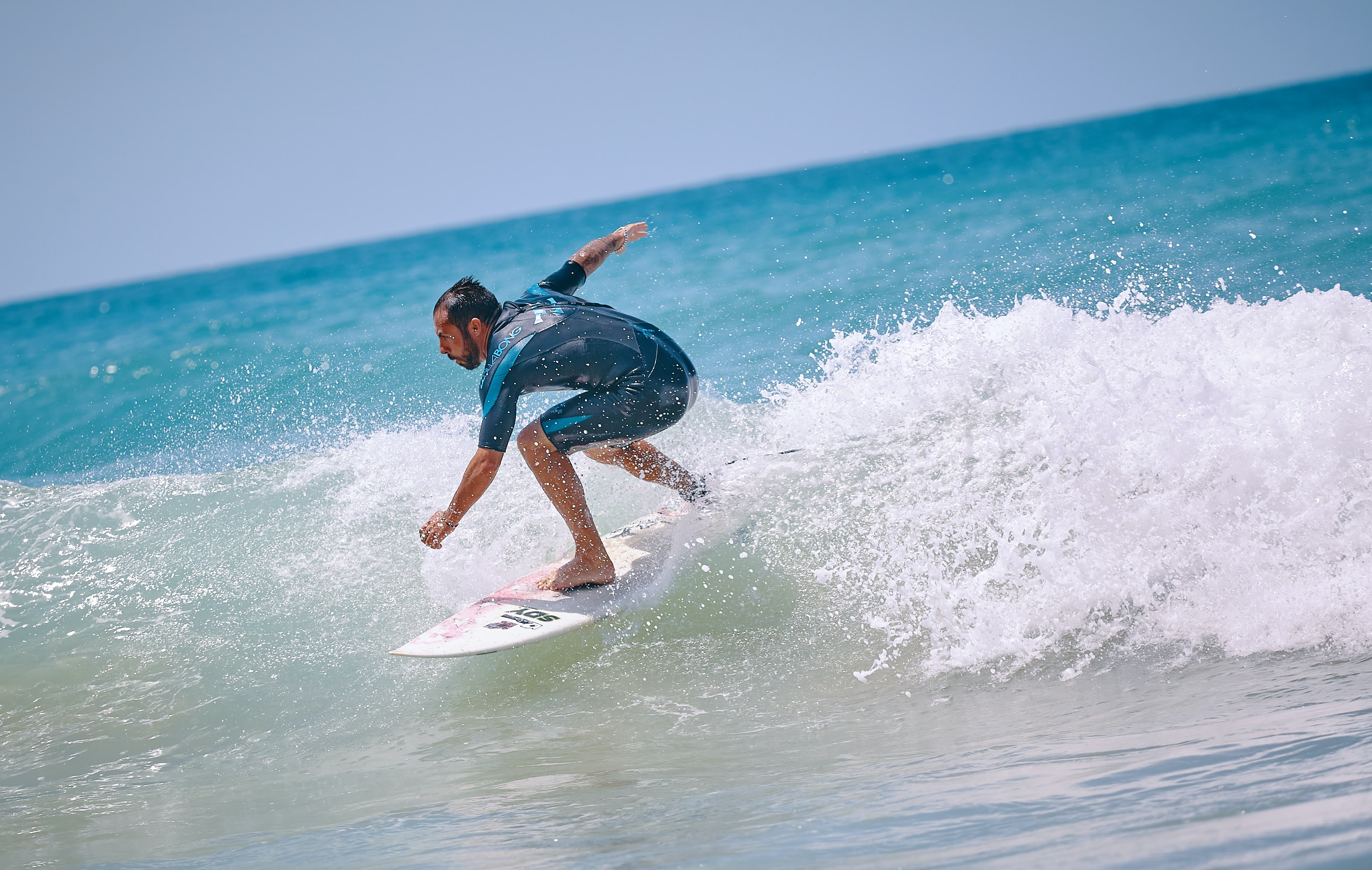 person riding a surfboard on a body of water