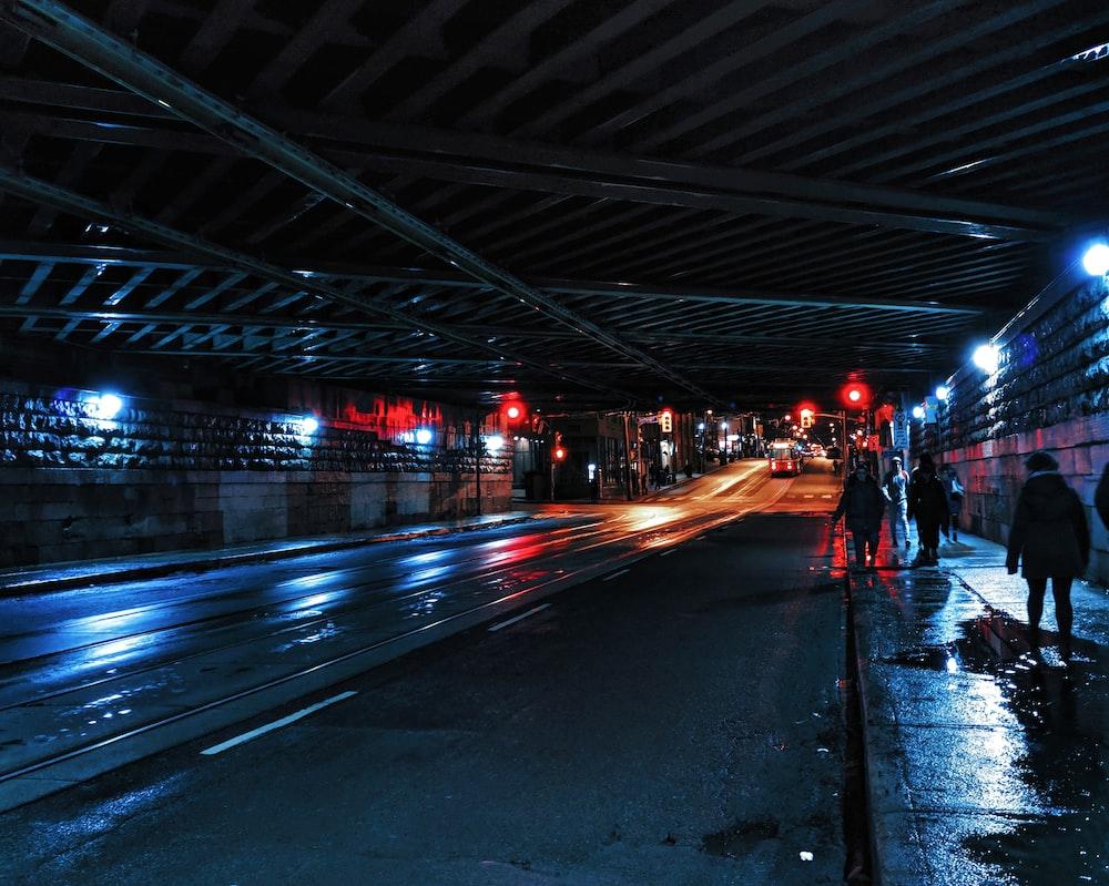 people walking on roadway