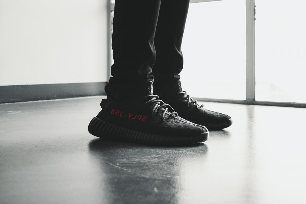 pair of black Adidas Yeezy Boost 350 V2