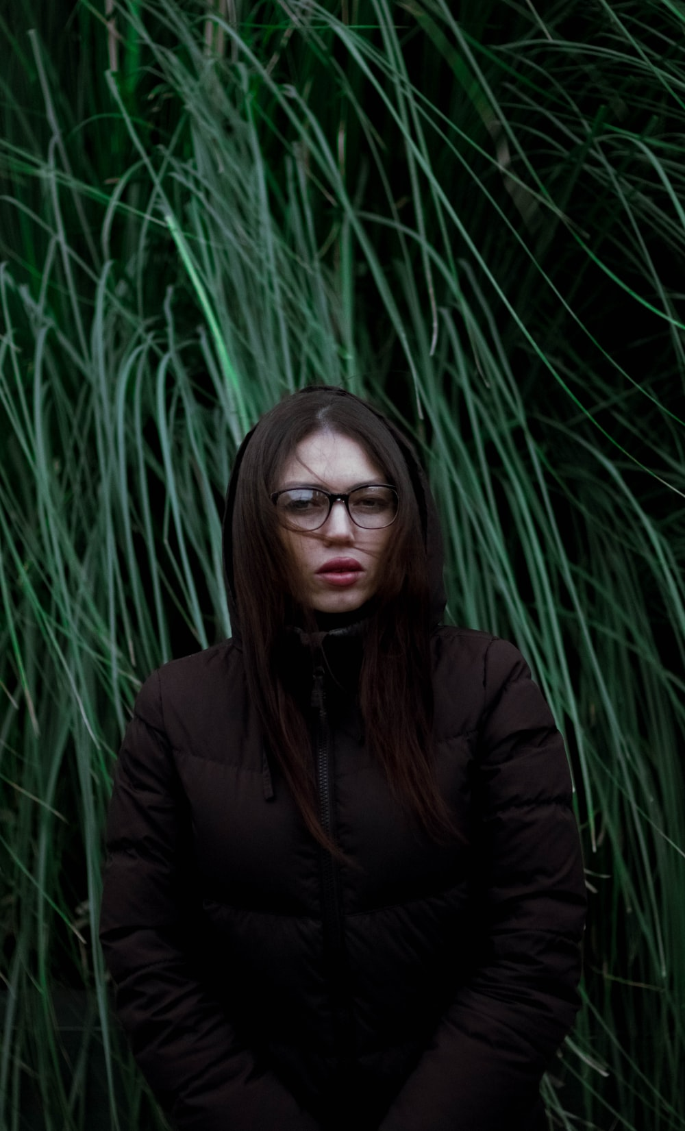 woman standing behind grass