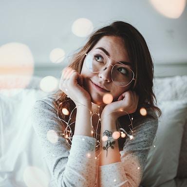 smiling woman looking upward