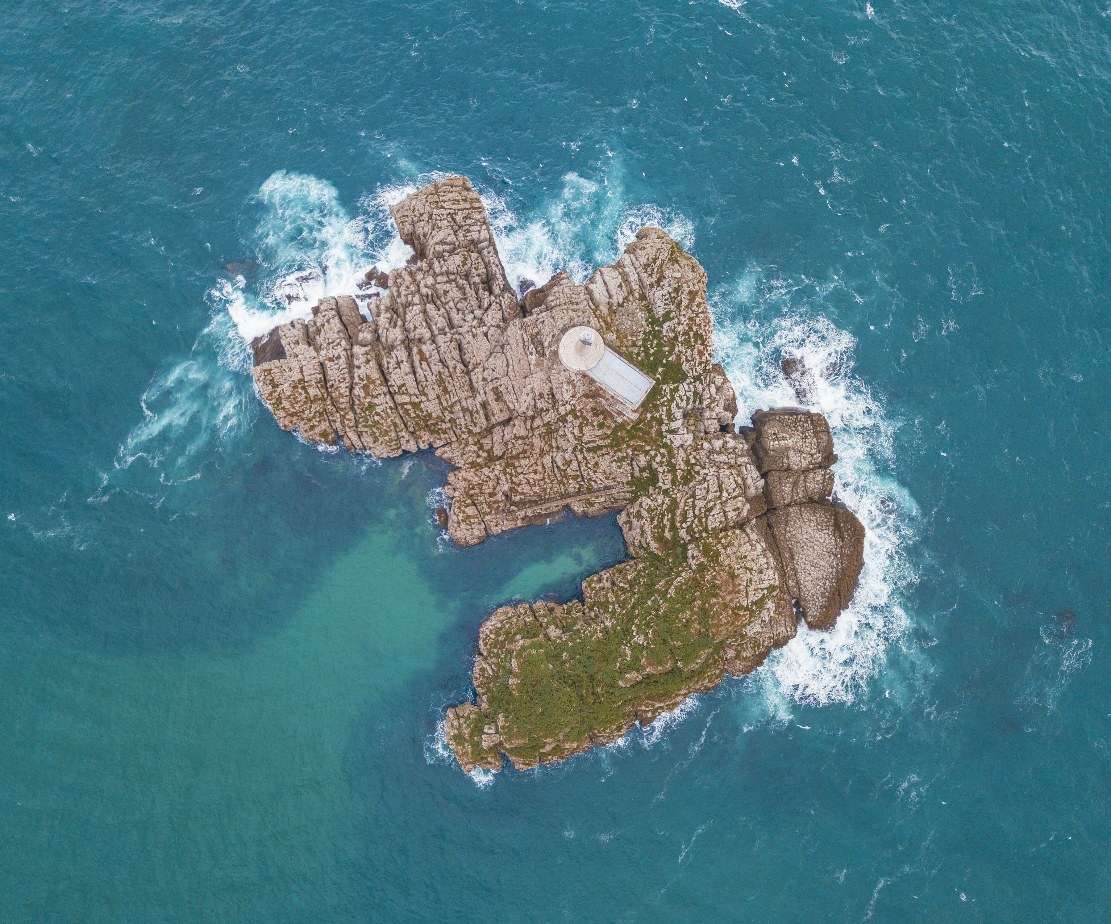 aerial photography of brown island surrounded by body of water at daytime
