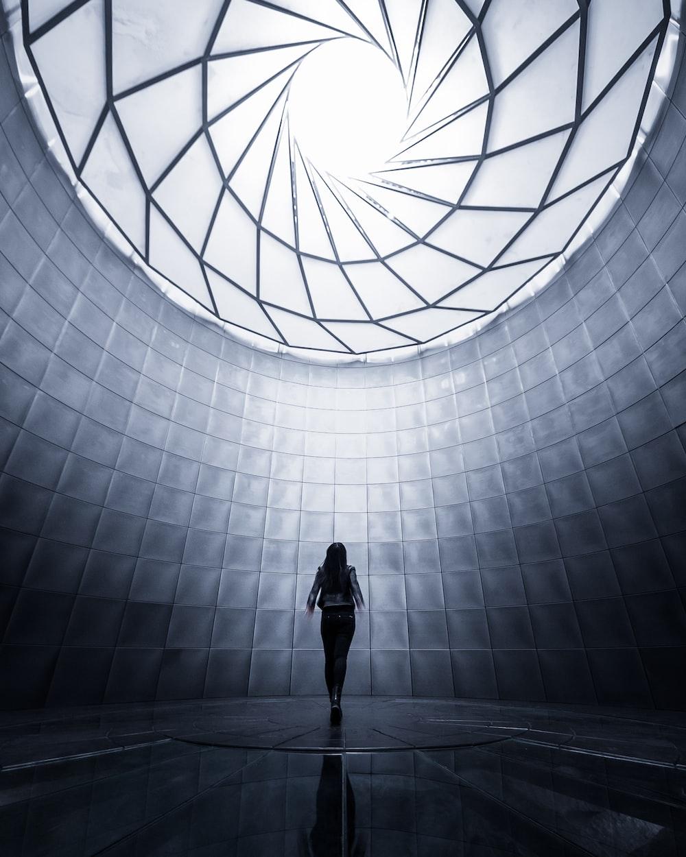 woman wearing black shirt facing the ceiling