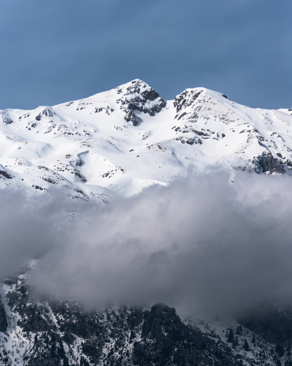 landscape photography of mountain covering snow and mist