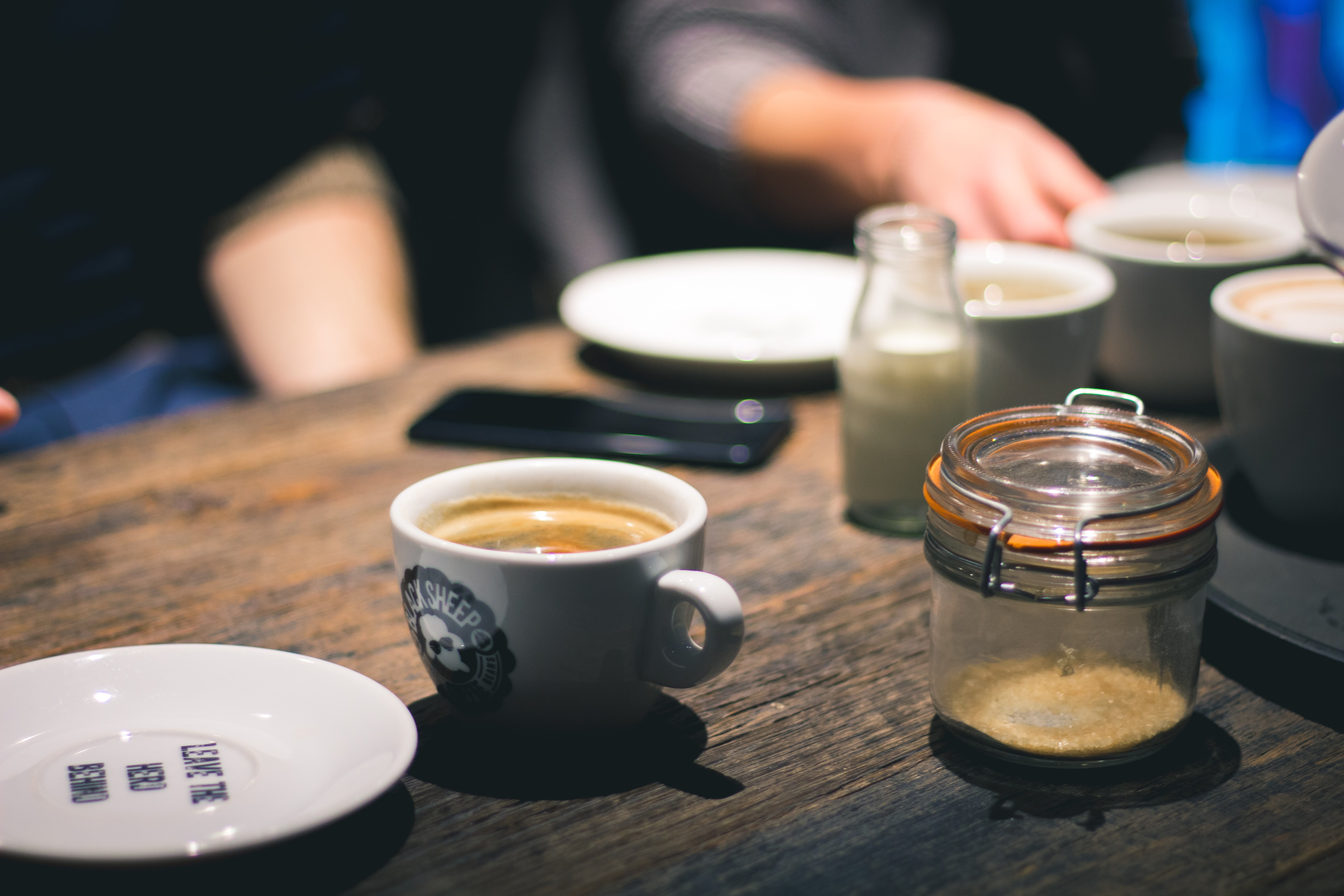 two person having tea and coffee