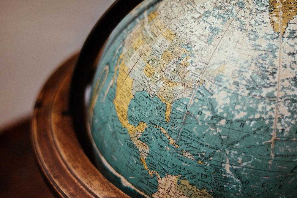 blue earth globe on table