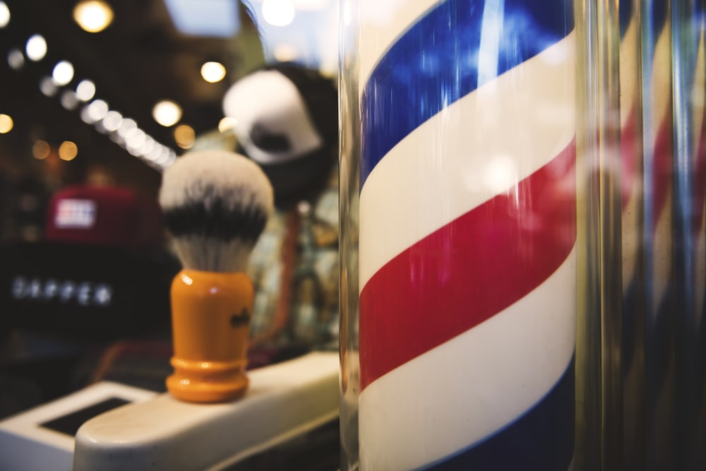 white, red, and blue barber spiraling bar