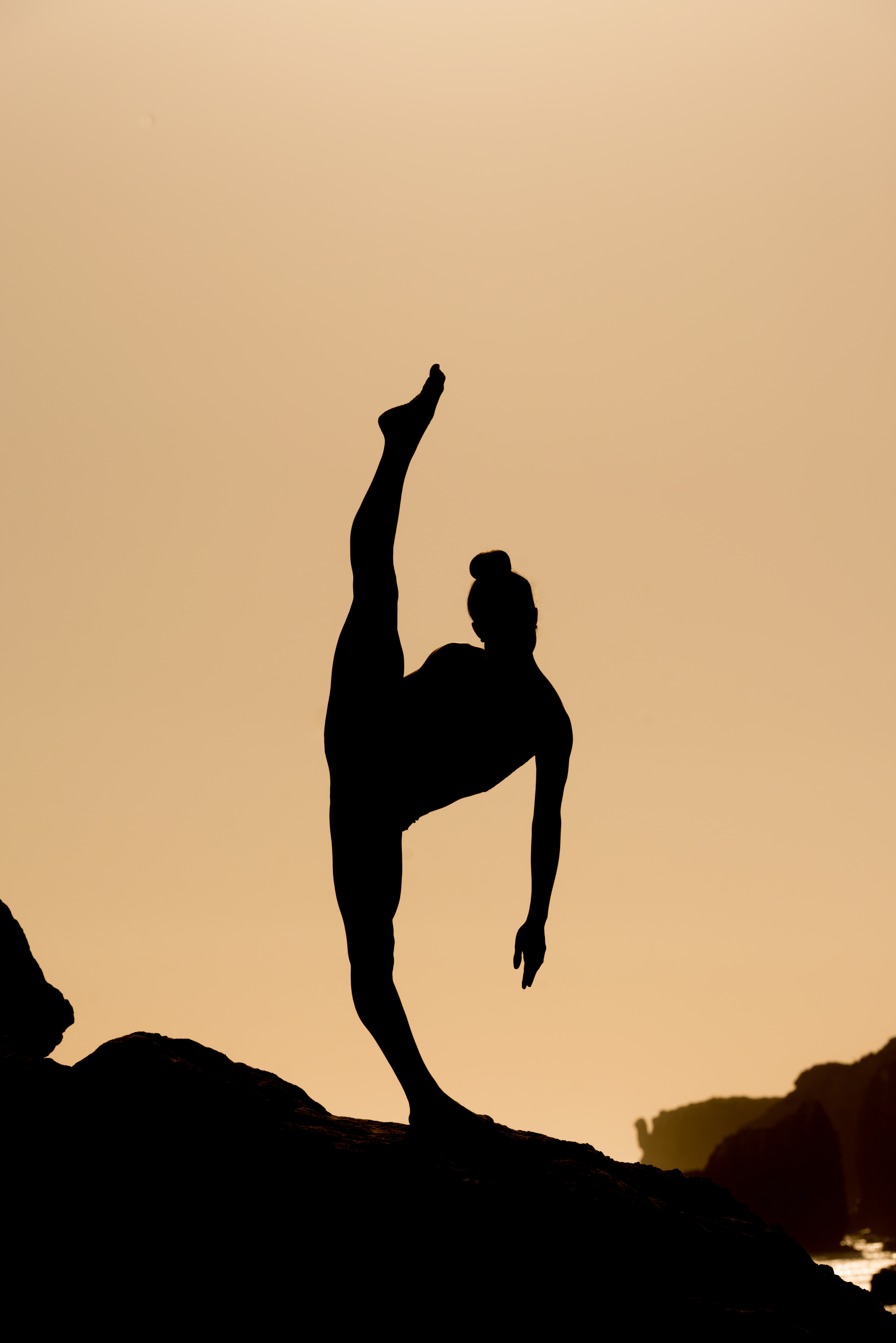 silhouette of woman doing oga