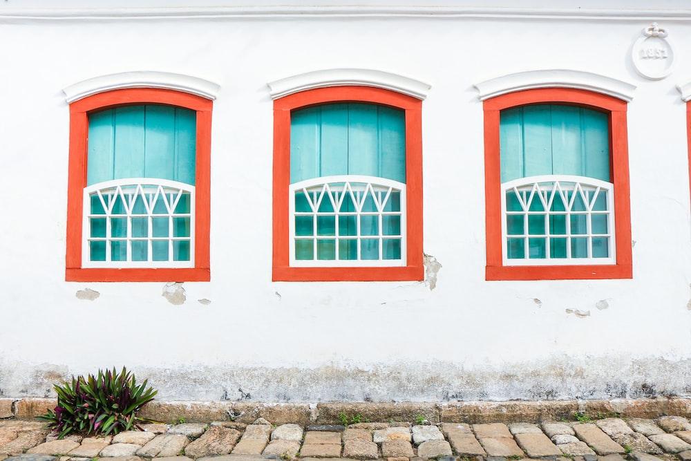 red metal framed glass window