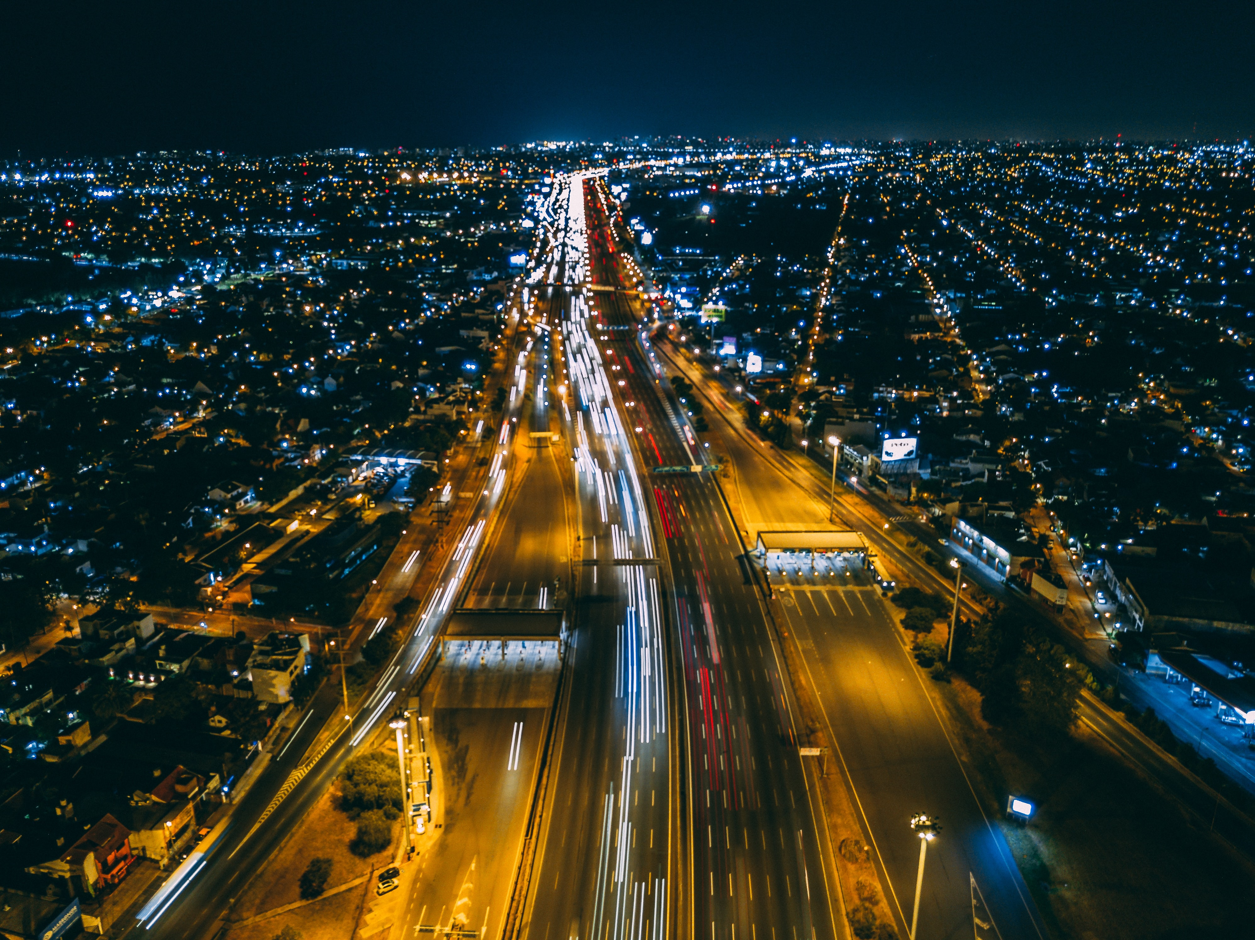 time-lapse photography of city buildings and road