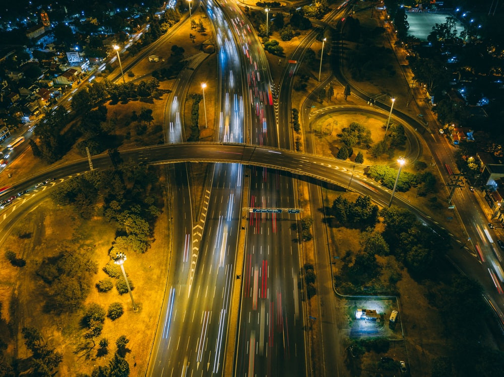 time-lapse photography of vehicle on road