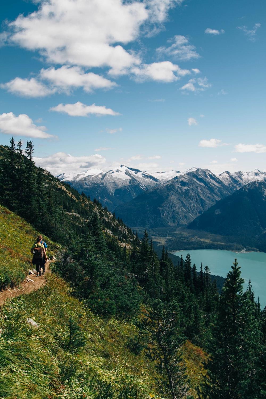person walking on mountain during daytime