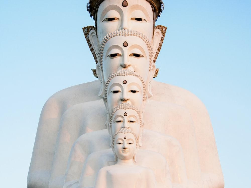 white Buddha statue during daytime