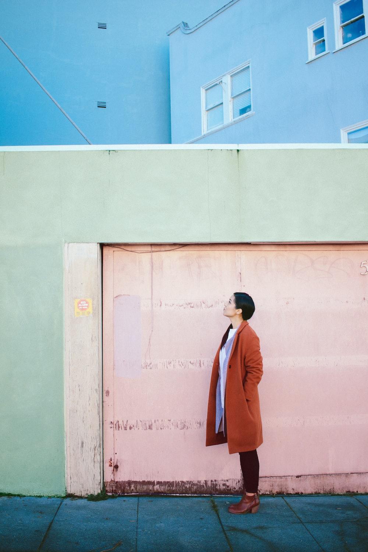 woman looking up in front of garage door