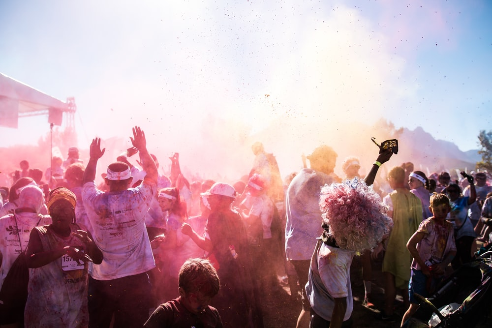 people dancing under blue sky during daytime