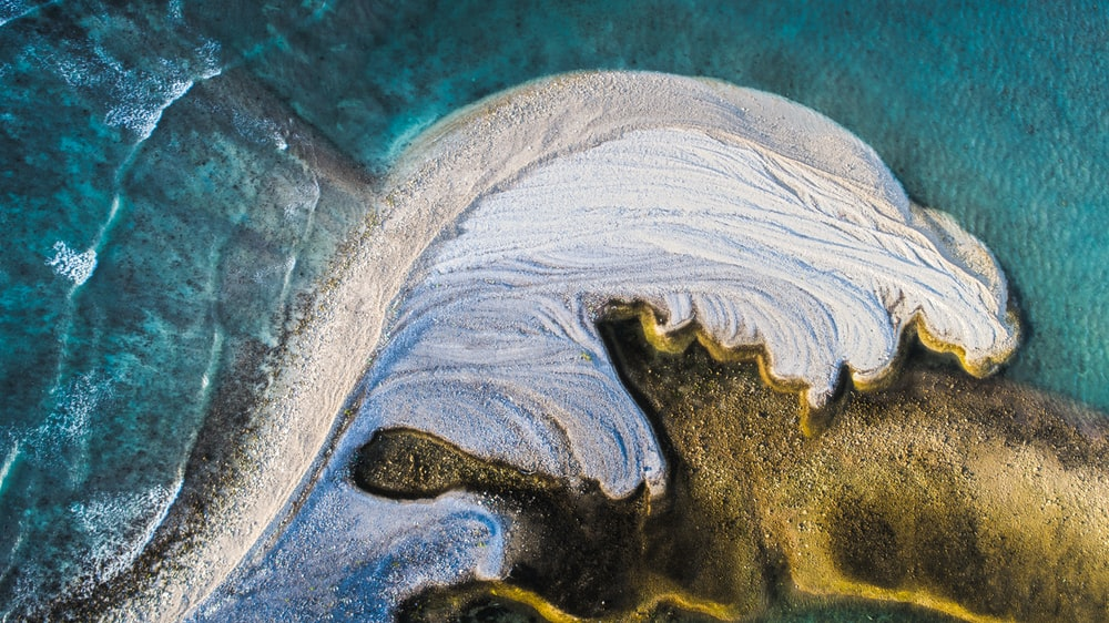 aerial photography of water and sand