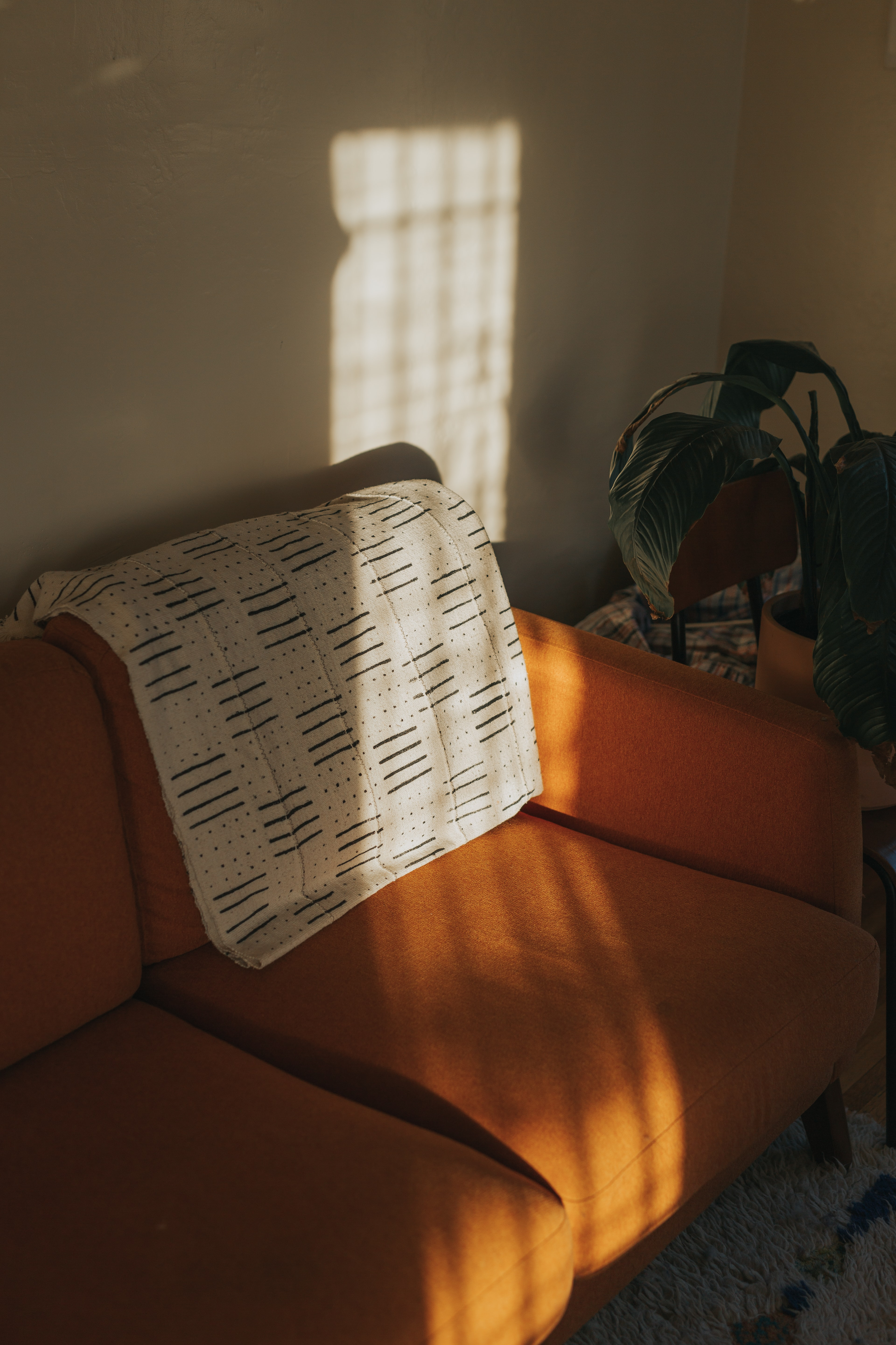 white textile on brown couch