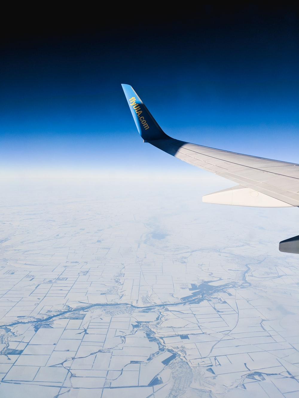 aerial photography of white and blue airplane