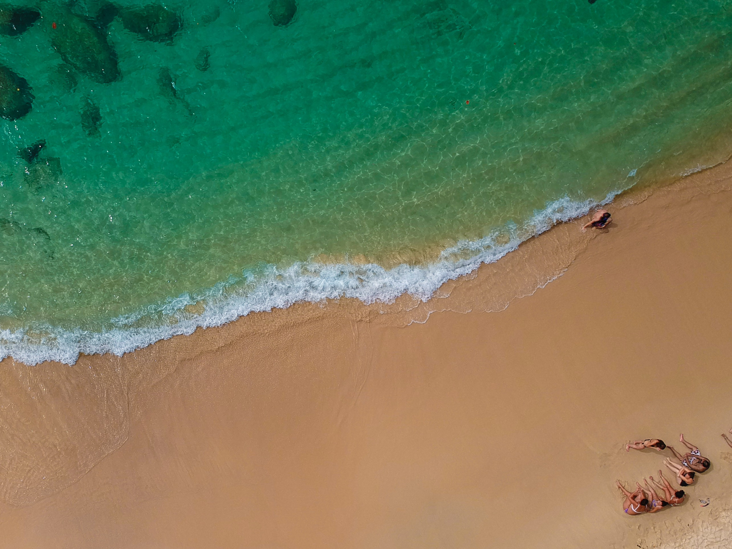 top view of people sitting on beach shore during daytrime