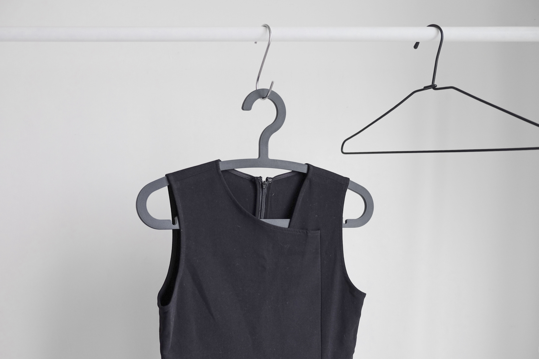 black sleeveless top hanging on wardrobe