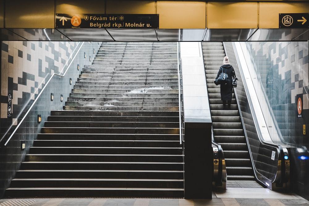 man at escalator going up