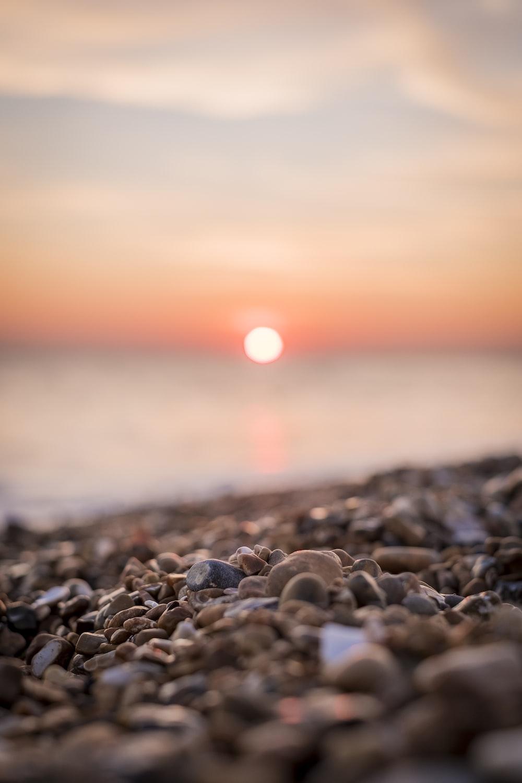 macro shot photography of brown pebbles